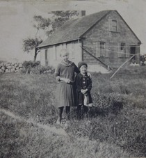 Boy and girl infront of old house